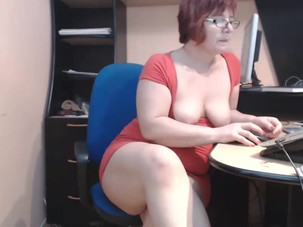 mature lady in office webcam..