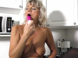 Sexy mature blonde with pink..