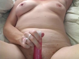 Wife pleasing her hairy pussy