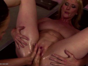 Mature gets her holes fisted by..