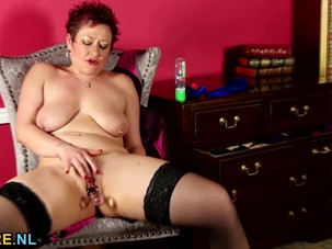 Shaved American mature toying..