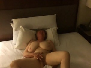 Busty mature lady having an..