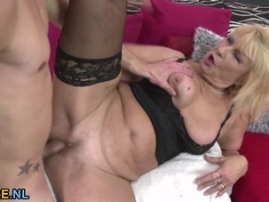 Busty blonde mature riding a..