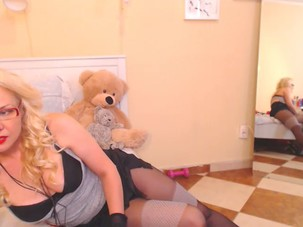 mature blond teases and dances..